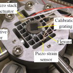Vibration and tracking control of a flexure-guided nanopositioner using a piezoelectric strain sensor (Invited Paper)